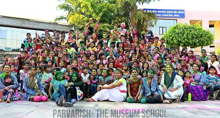 Children and volunteers celebrating Holi at Parvarish : The Museum School