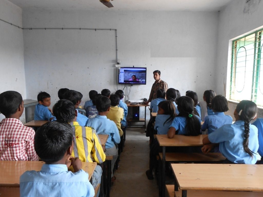Volunteer teaching children through Skype
