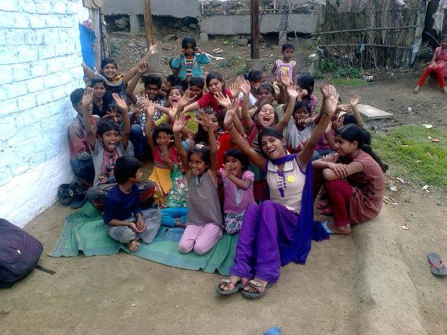 Niharika enjoying with the slum children