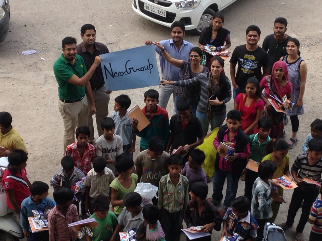 Users of NearGroup App gather together to celebrate festivals with slums children in the nearby slum