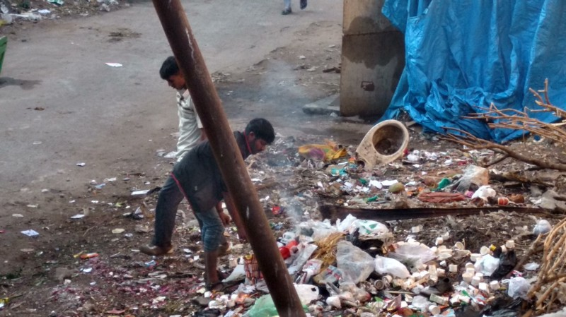 Sanitation workers are ill-protected against the hazardous waste in roadside dumps