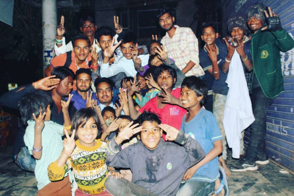 Students distributing blankets among the poor and impoverished