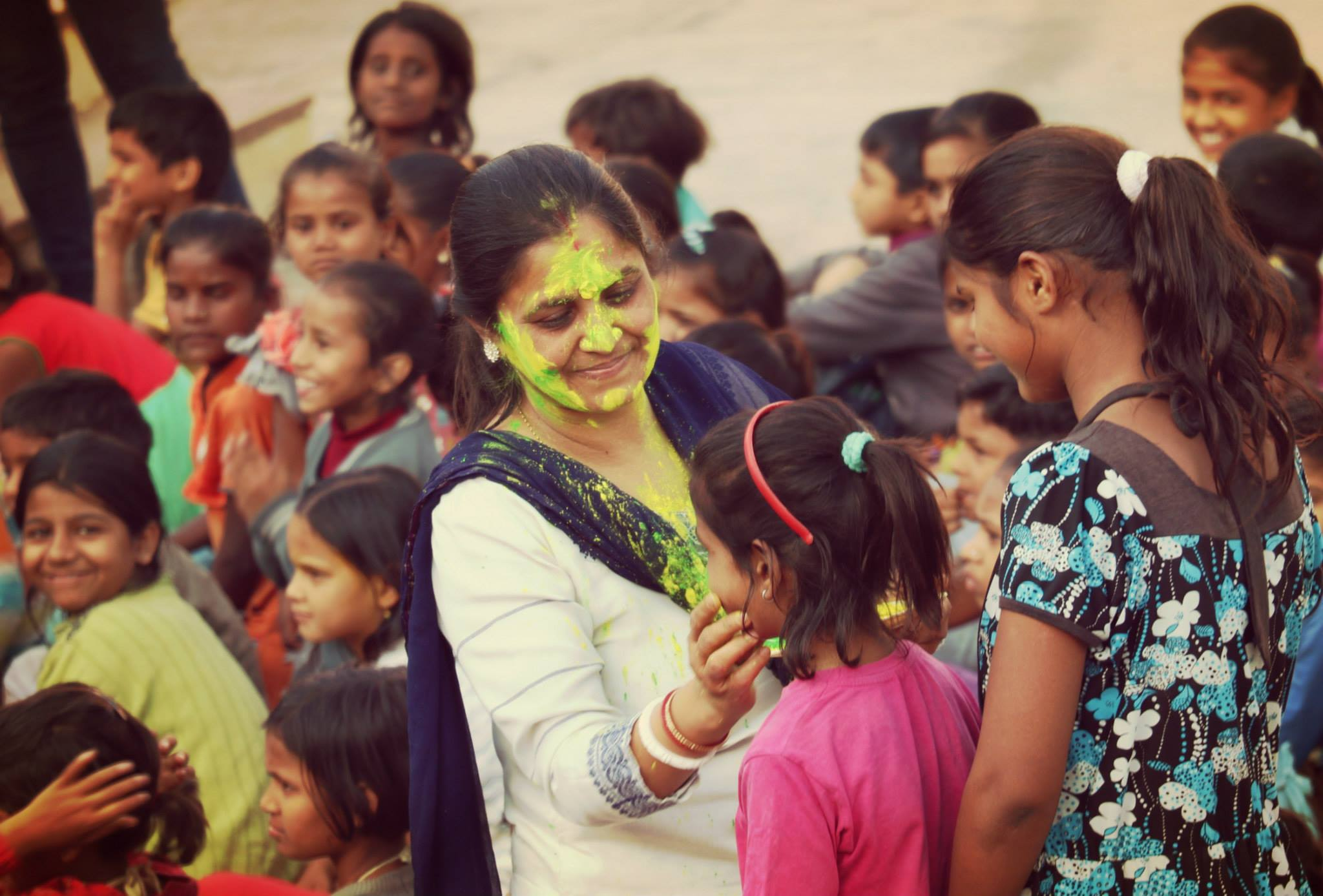 Mrs. Shibani Ghosh (Project Coordinator) of Parvarish celebrating Holi with the children