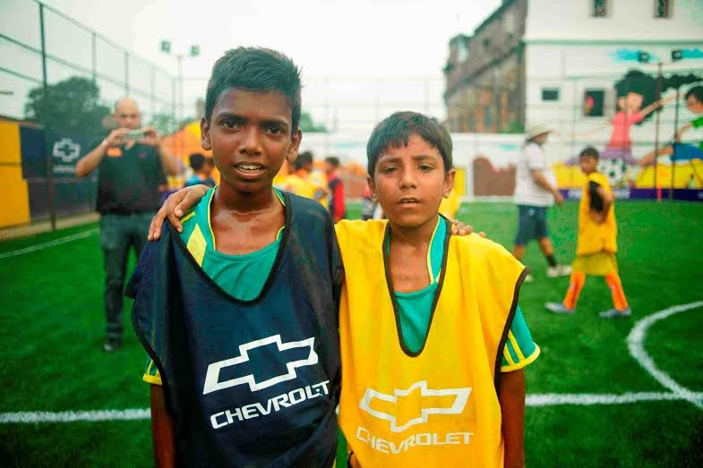 Sonu (L) and Sharik, the two kids from India who will be mascots in the big game