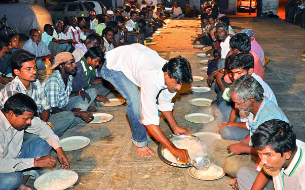 Azhar Maqsusi serving food to the poor and the needy