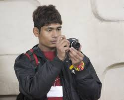 Arjun honing his skills as a photographer