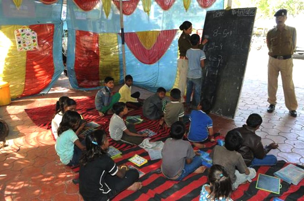 Hanunganj Police Thana Cops teaching the children of nearby Slums