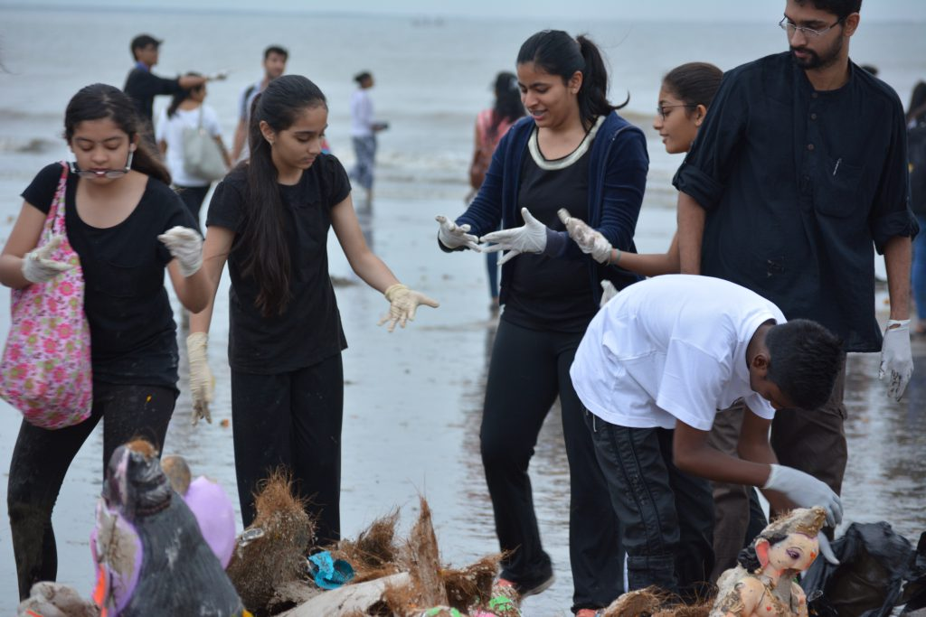 Students cleaning Juhu Beach after Ganpati Visarjan