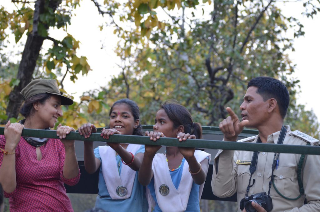 Students and volunteers interacting with the forest officials