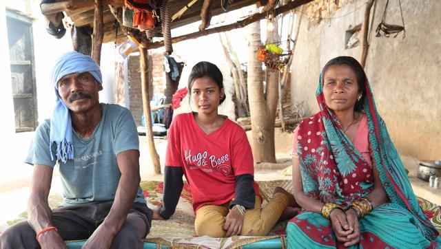 Asha Gond with her family in her village