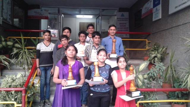 Students from Project Checkmate after having won accolades at a tournament. A regular sight for many students training in the initiative | Image Courtesy : Project Checkmate