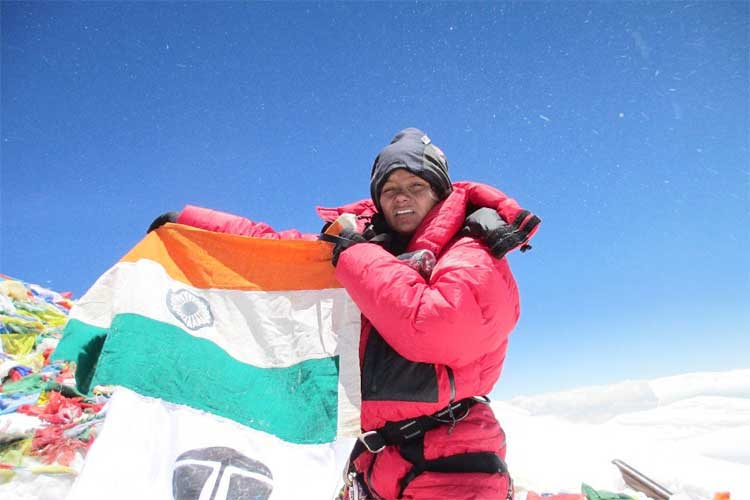 Arunima Sinha holding the Indian Flag at Mount Everest