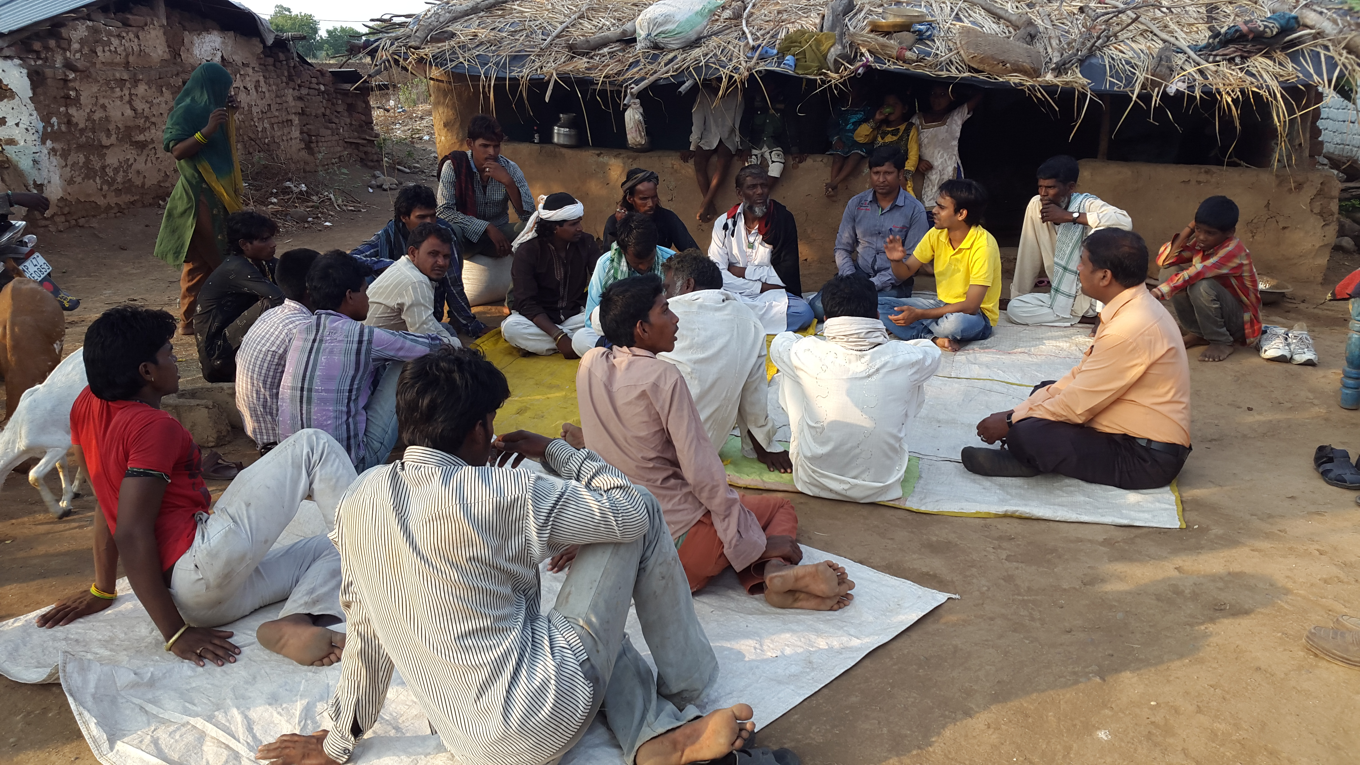 Founders Ritesh Gohiya and Sunil Pal in discussion with the parents of rural youth | Image courtesy: SHEDO