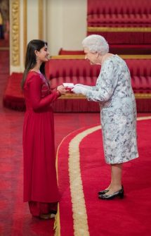 Suhani Jalota receiving the honour from Queen Elizabeth II