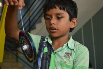 A boy with an Ahimsa Toy