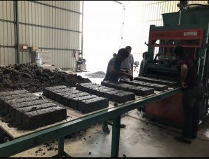 Snippet of the factory where workers recycle PPE kits into bricks