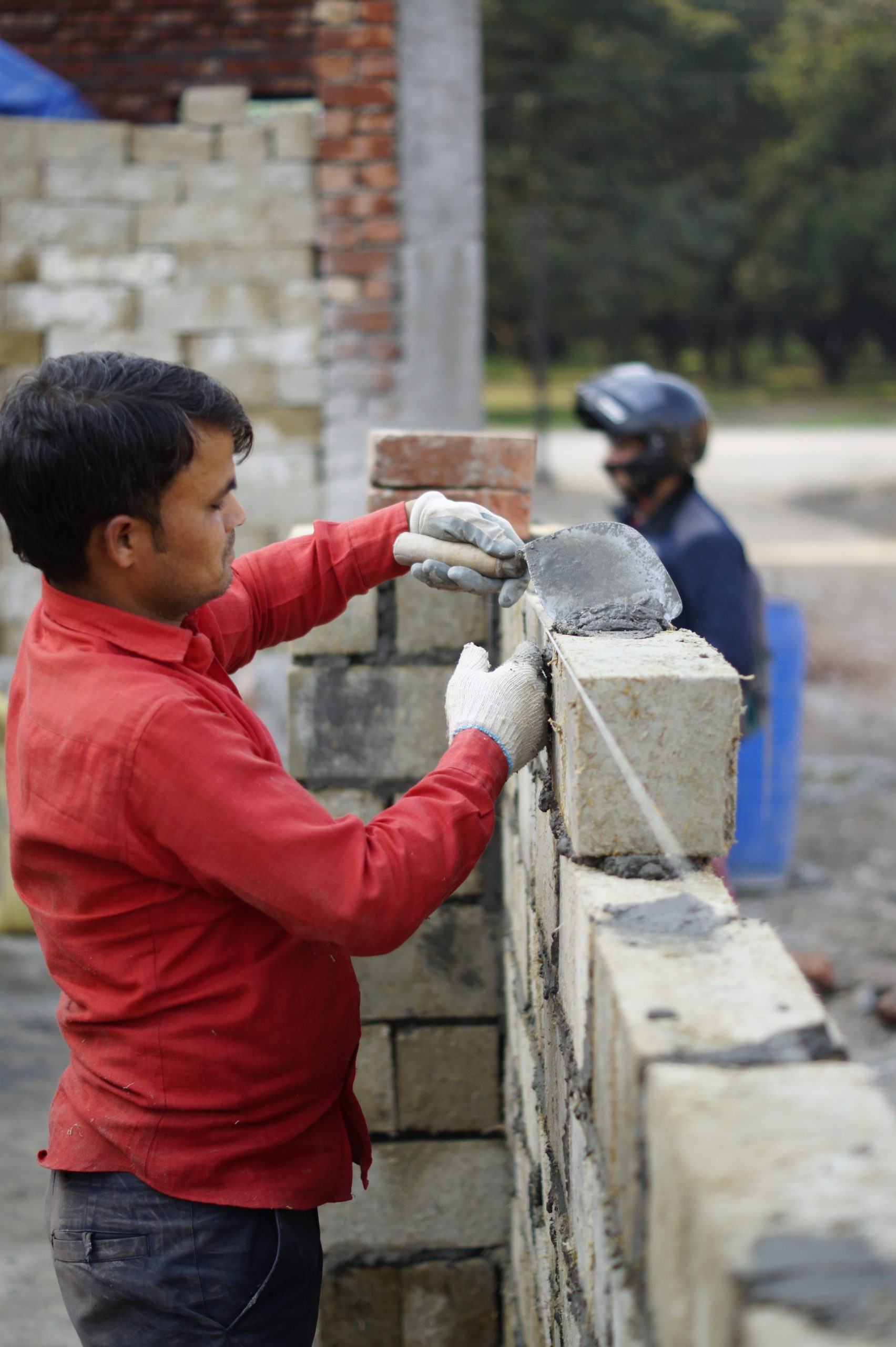 The brick reduces construction costs by 50% and is a 'classic solution' to the stubble burning issue that causes alarming pollution levels in Delhi.